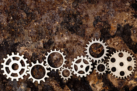 gearing: lots of gears on rusty background, concept gearing and mechanical Stock Photo