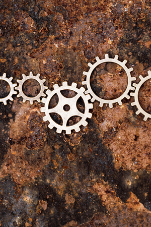 mechanical works: gears works together, concept mechanical and technology, rusty background