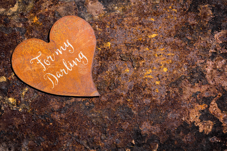 rusty heart on rusty background, english text for my darling