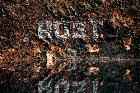 German word for Rust on rusty background, reflection Stock Photo