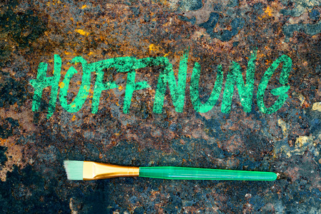 brush and german word, color symbolism for the color green, it means hope Stock Photo