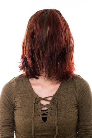 woman with red highlights in the hair, needs a haircut