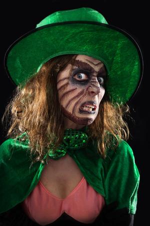 a evil green goblin girl, black background