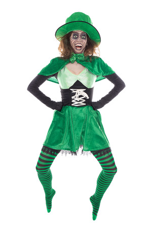 funny jumping Leprechaun girl, isolated on white, concept st. Patrick?s Day