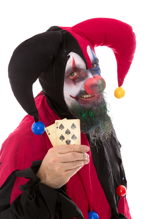 madly: a madly clown holding playing cards, isolated on white, concept gambling Stock Photo