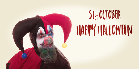 creepy clown looking at text Happy Halloween, vintage filtered
