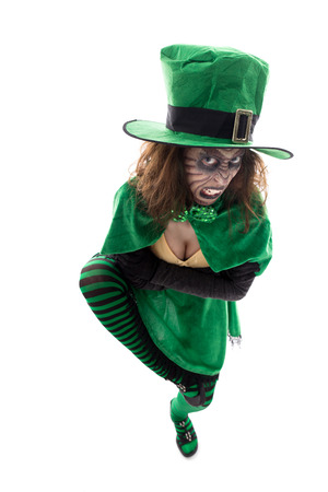 a evil leprechaun girl, isolated on white, concept ireland and fairytales Stock Photo