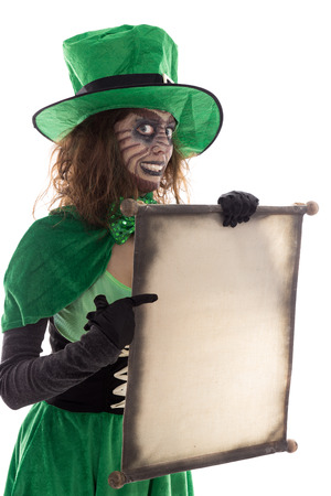 a green goblin girl holding a scroll with copyspace, isolated on white
