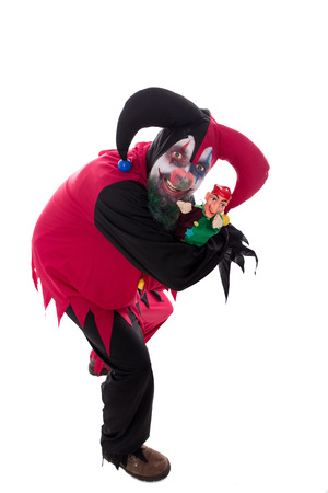 psychopath: a evil clown holding a punch, isolated on white, concept halloween and horror Stock Photo