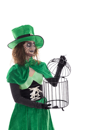 a green Goblin girl holding a birdcage, isolated on white