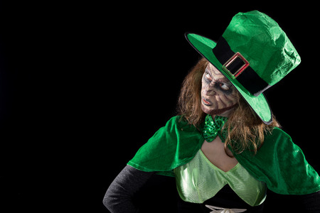 green leprechaun girl looking to copyspace, black background, concept st. patrick´s day Stock Photo