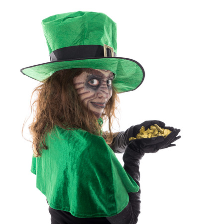 a Leprechaun girl holding a gold treasure, concept st. patrick�s day and ireland
