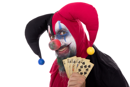 madly: a madly Fool holding playing cards, concept gambling, isolated on white