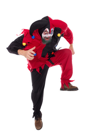 psychopath: a evil dancing clown, isolated on white, concept Halloween and carnival Stock Photo