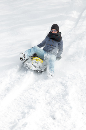 sledging people: young woman sledging in the deep snow and have fun