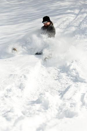 slump: man sledging in deep snow, concept winter and fun