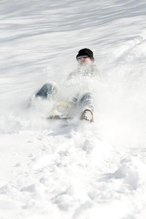 slump: a man sledging in deep snow, concept sleigh ride and winter