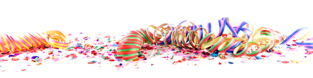 Colorful confetti and streamers in front of white background
