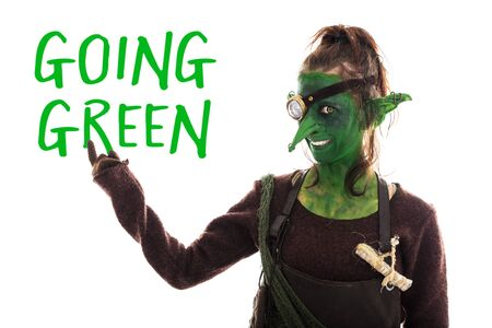 going green: green goblin pointed of text going green, sustainable development, isolated