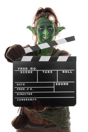 goblin: Goblin or imp holding a clapperboard, isolated on white