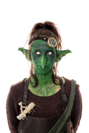 goblin: female green goblin looking to the left, isolated on white Stock Photo