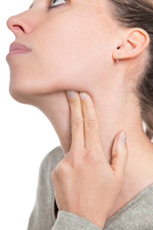 young woman gropes her lymph nose, concept influenza or lymphadentitis, isolated on white Stockfoto