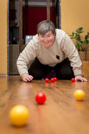 mentally disabled woman playing with balls, learning and study withfun Stock Photo