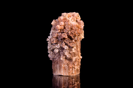 esoterism: Aragonite gemstone, black background with reflections, mineral and healing stone