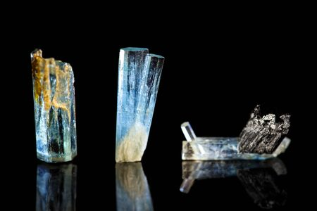 Three blue Tourmaline, Indicolite, black background, healing stone, mineral, reflections Stock Photo