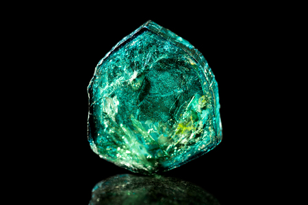 chakra energy: Green Tourmaline, black background, mineral, healing stone, reflection