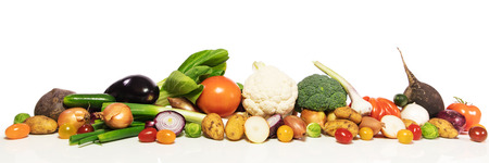 panorama with various vegetables in front of white background