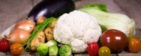 ingredients for vegetable soup or stew on a rustic wooden background