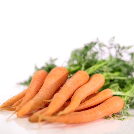 carrot: fresh carrots in front of white background Stock Photo