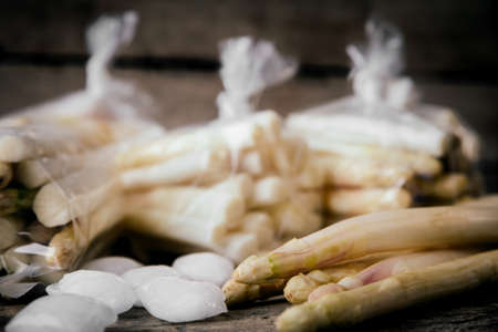 White asparagus which is frozen in bags Stock Photo
