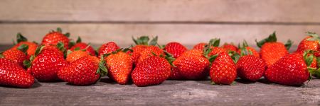 Banner, lots of fresh organic strawberries on wooden table