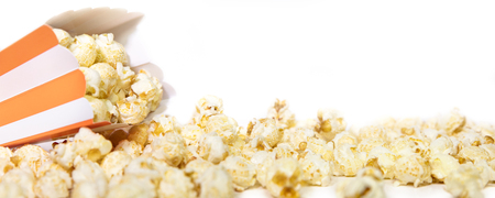Panorama, striped orange Popcorn box in front of white, copyspace Stock Photo