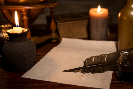 a old parchment paper with a quill and ink, medieval theme with copyspace