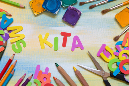 colorful letters, school supplies, german word Kita, which means kindergarten