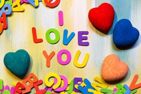 colorful letters and hearts, text i love you