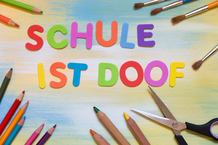colorful lettes, german text schule ist doof, which means dumb or silly school