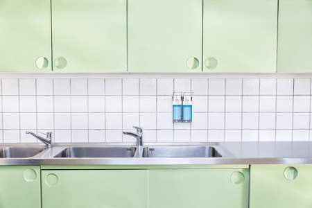 washing room in hospital with nobody in it, desinfecting agent dispenser