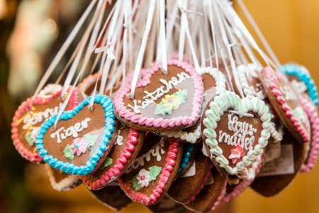 lots of Gingerbread hearts with german words and messages, concept christmas market or octoberfest, funfair