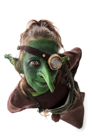 funny green goblin with a monocle, isolated on white Stock Photo