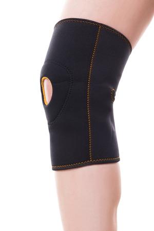 Female leg with a elastic knee bandage, isolated on white, concept orthosis and orthopedic