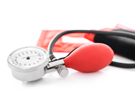 Closeup of a blood pressure monitor or sphygmomanometer, white background 版權商用圖片