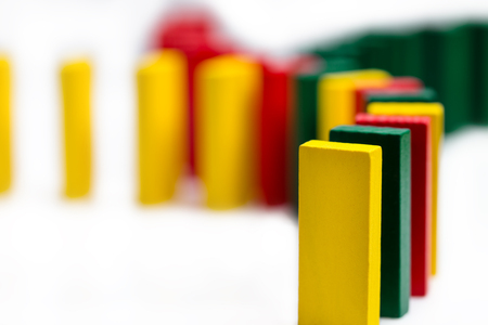 colorful dominos on white background coming together, concept connection or global networking, horicontal