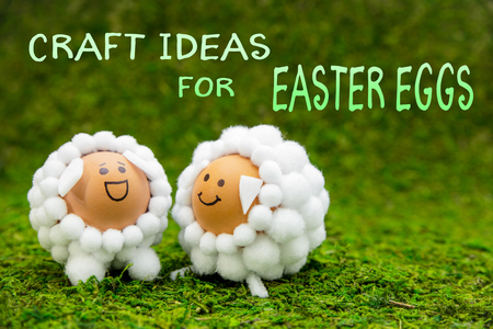 Craft ideas for easter eggs, two funny lambs or sheep shaped eggs on green moss, english text