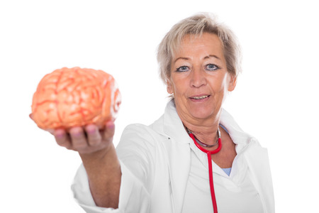 female doctor is holding an plastic brain, looking to the viewer,  isolated in front of white Stock Photo