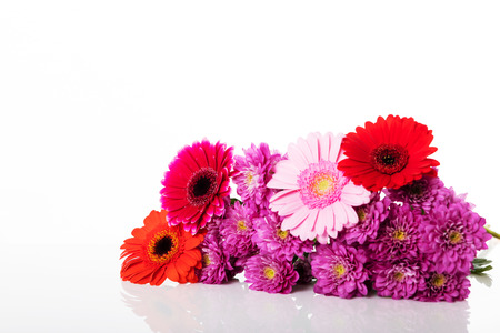 decoration with various flowers in front of a white background