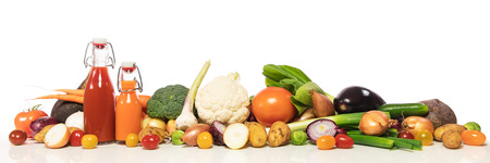panorama with various vegetable ingredients  in front of white background, concept vegetable juice, stew or soup